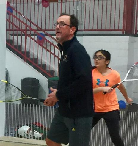 Photo of squash coach Ned Sparrow coaching juniors on the squash club in Baltimore
