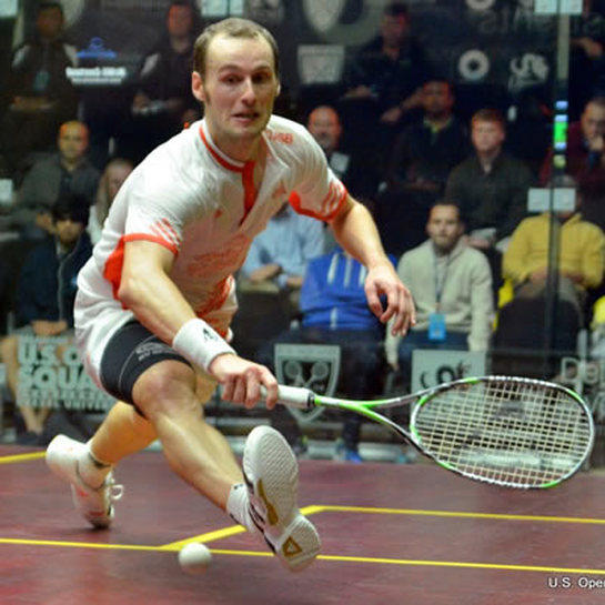 Greg Gaultier plays in a squash tournament