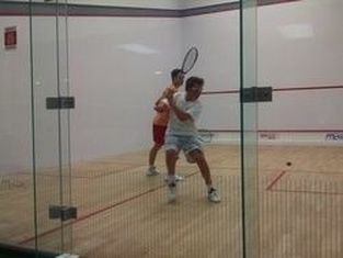 Two players in a squash match round robin in DC