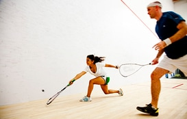 Two squash players on the court at a Junior Squash Program by Squash Revolution in Bethesda MD