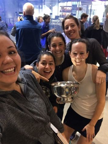 Picture of the A squash team winning the Howe Cup