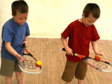 Image of two children during their mini squash lesson in DC