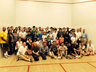 A large group of squash players at a Squash Revolution program