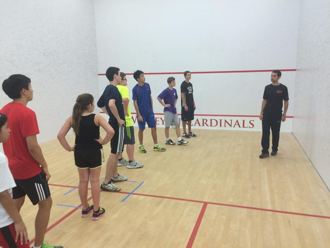 Shahier Razik coaches a squash camp on the squash sport court in DC