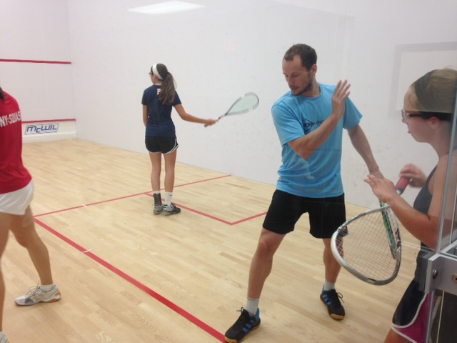 Squash players are coached by Greg Gaultier at a squash camp at the sport courts in Toronto
