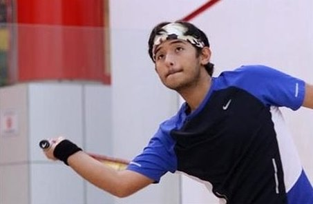 Photo of squash pro Mubarak Moshin on the squash court