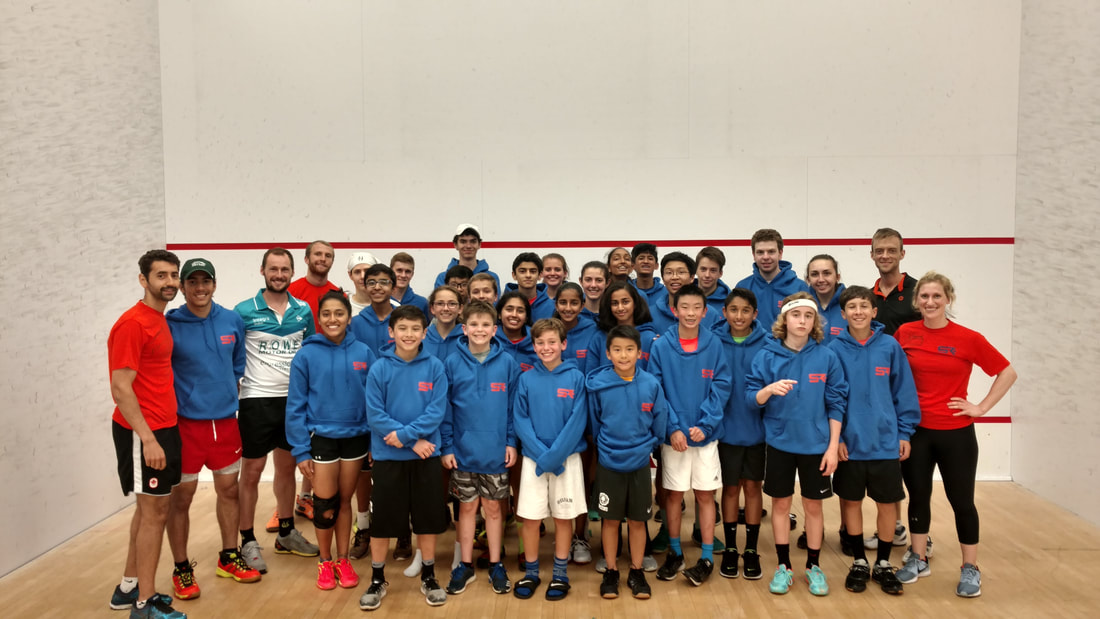 Squash camp players on the courts at Squash Revolution in DC