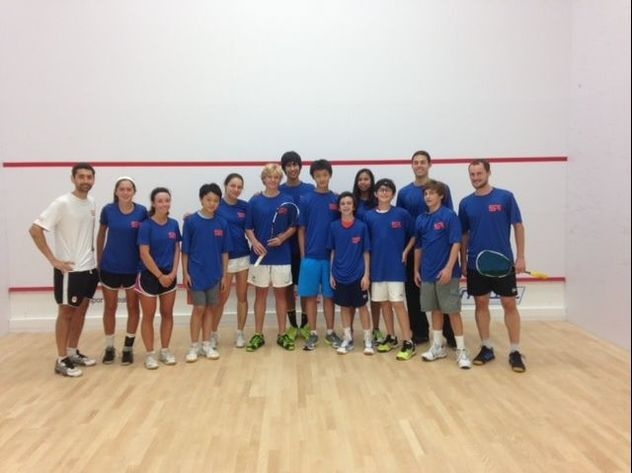 Photo of squash players on a squash court at Squash Revolution