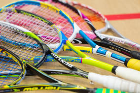 An image of squash rackets on the Squash Revolution courts