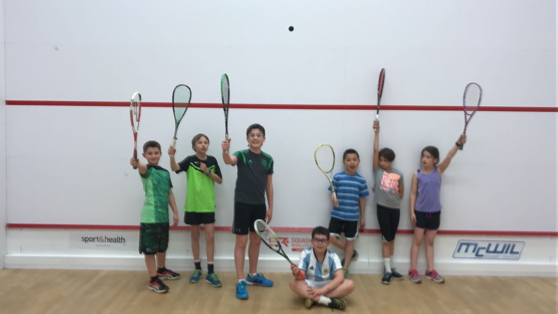 Squash school players on the squash court in DC